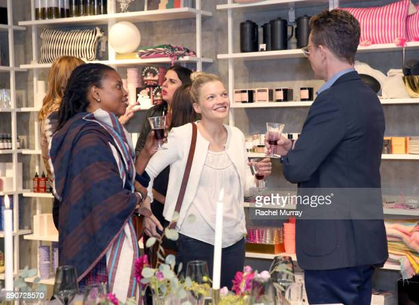 Samie Barr Agnes Baddoo and Domino CEO Nathan Coyle at the Domino Outpost CB2 Influencer Dinner at Fred Segal on December 11 2017 in Los Angeles...