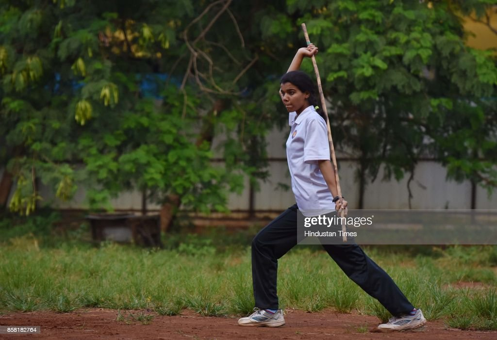 Samiksha Sukate displays Single Stick, a type of Silambam, a weapon based Indian Martial arts, on October 4, 2017 in Pune, India. The word Silambam means either a mountain or merely to sound (as verb). While the Silambam fencers are fighting, the weapon makes sound. This might have been the cause for its being named as Silambam.