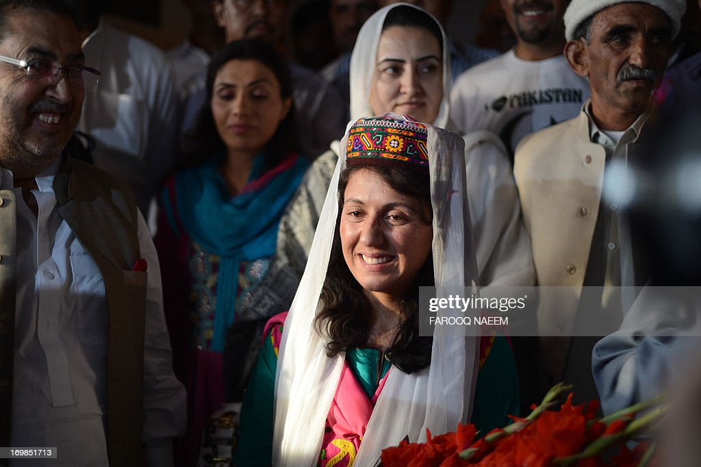 Samina Baig, the first Pakistani woman climber to summit the world's highest peak Mount Everest, smiles on her arrival at Banezir airport in Islamabad on June 3, 2013. The 22-year-old Baig, from the small town of Shimshal in the Hunza valley in Pakistan's mountainous north, scaled the 8,848 metre (29,029 feet) peak early on 19 May after a gruelling expedition in rough weather. AFP PHOTO/Farooq NAEEM