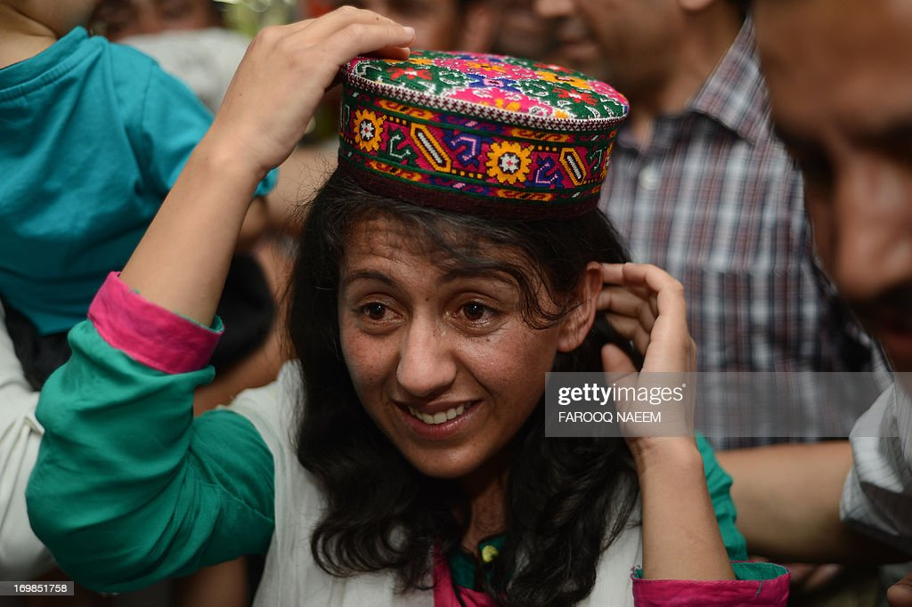 Samina Baig, the first Pakistani woman climber to summit the world's highest peak Mount Everest, gestures on her arrival at Banezir airport in Islamabad on June 3, 2013. The 22-year-old Baig, from the small town of Shimshal in the Hunza valley in Pakistan's mountainous north, scaled the 8,848 metre (29,029 feet) peak early on 19 May after a gruelling expedition in rough weather. AFP PHOTO/Farooq NAEEM