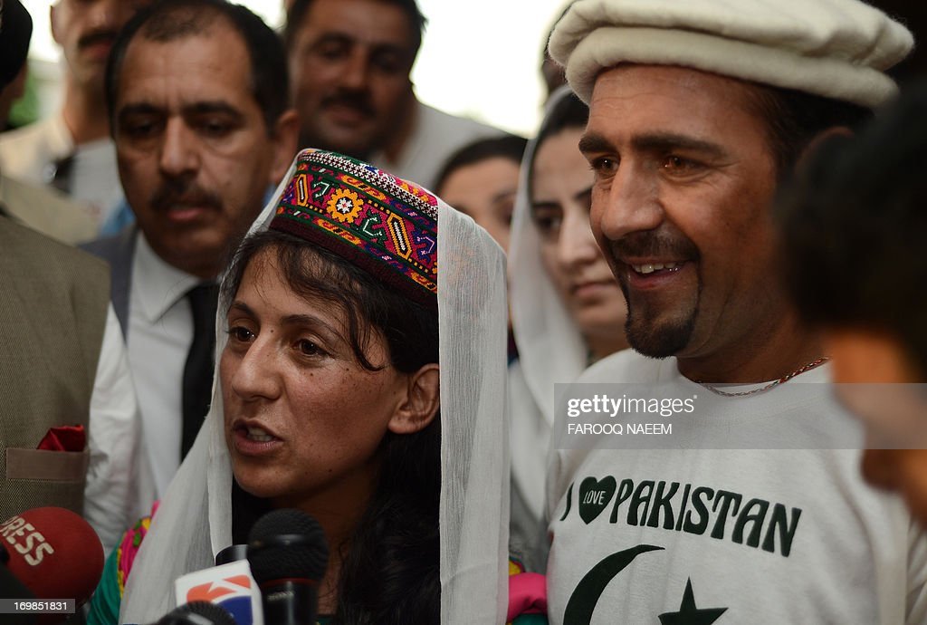 Samina Baig, (L) the first Pakistani woman climber to summit the world's highest peak Mount Everest, speaks to journalists on her arrival at Banezir airport in Islamabad on June 3, 2013. The 22-year-old Baig, from the small town of Shimshal in the Hunza valley in Pakistan's mountainous north, scaled the 8,848 metre (29,029 feet) peak early on 19 May after a gruelling expedition in rough weather. AFP PHOTO/Farooq NAEEM