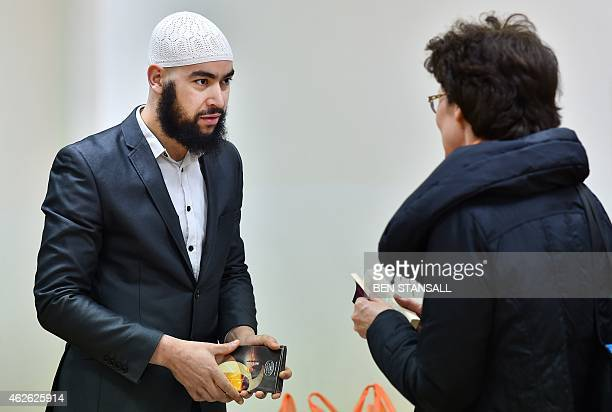 Samir a member of the mosque speaks to a visitor during an open day at Finsbury Park Mosque in London on February 1 2015 Mosques around the UK opened...