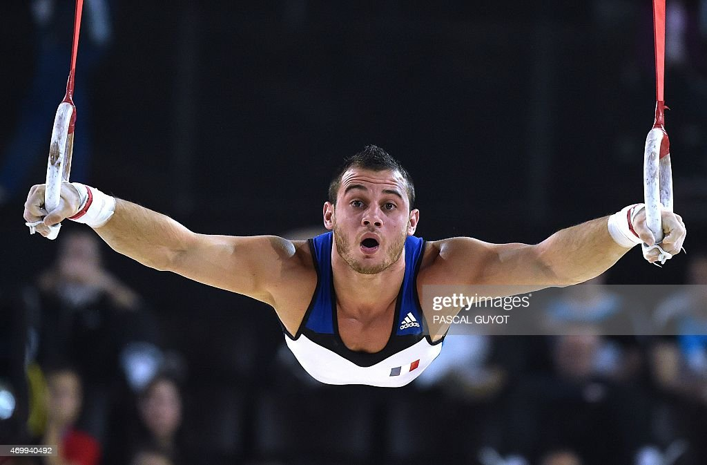 <a gi-track='captionPersonalityLinkClicked' href=/galleries/search?phrase=Samir+Ait+Said&family=editorial&specificpeople=6367885 ng-click='$event.stopPropagation()'>Samir Ait Said</a> of France competes in a qualifying round of the Rings event of the European Men's Artistic Gymnastics Championships on April 16, 2015 in Montpellier, southern France. AFP PHOTO / PASCAL GUYOT