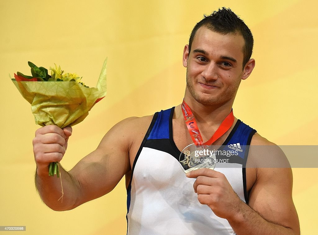 Samir Ait Said of France poses on the podium during the medal ceremony of the Rings event during the European Men's artistic gymnastics individual championships in Montpellier, southern France on April 18, 2015. Ait Said won the silver medal. AFP PHOTO / PASCAL GUYOT