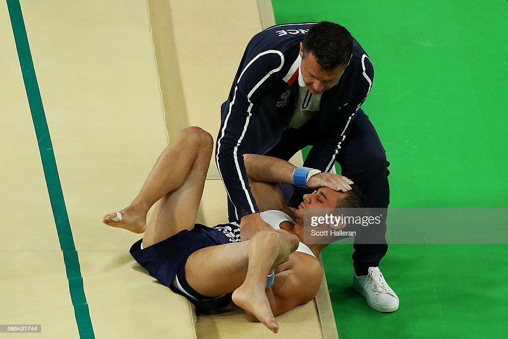 Samir Ait Said of France receives attention after breaking his leg while competing on the vault during the Artistic Gymnastics Men's Team qualification on Day 1 of the Rio 2016 Olympic Games at Rio Olympic Arena on August 6, 2016 in Rio de Janeiro, Brazil.