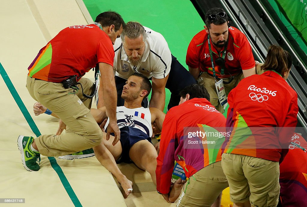 Samir Ait Said of France receives medical attention after breaking his leg while competing on the vault during the Artistic Gymnastics Men's Team qualification on Day 1 of the Rio 2016 Olympic Games at Rio Olympic Arena on August 6, 2016 in Rio de Janeiro, Brazil.