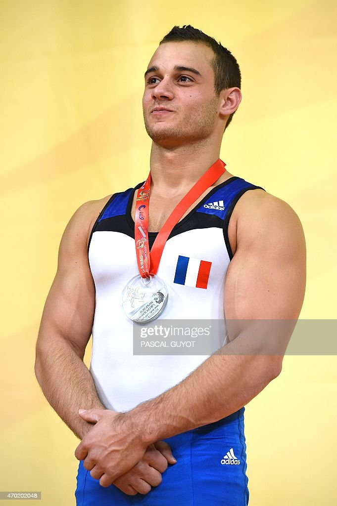 Samir Ait Said of France stands on the podium after winning a silver medal during the medal ceremony for the Rings event during the European Men's artistic gymnastics individual championships in Montpellier, southern France on April 18, 2015. AFP PHOTO / PASCAL GUYOT
