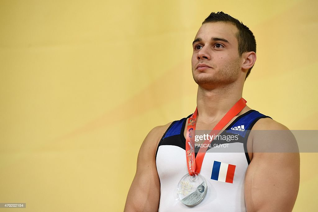 <a gi-track='captionPersonalityLinkClicked' href=/galleries/search?phrase=Samir+Ait+Said&family=editorial&specificpeople=6367885 ng-click='$event.stopPropagation()'>Samir Ait Said</a> of France stands on the podium after winning a silver medal during the medal ceremony for the Rings event during the European Men's artistic gymnastics individual championships in Montpellier, southern France on April 18, 2015. AFP PHOTO / PASCAL GUYOT