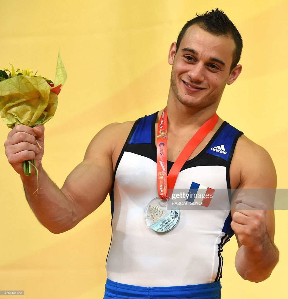 Samir Ait Said of France stands on the podium after winning a silver medal during the medal ceremony for the Rings event during the European Men's artistic gymnastics individual championships in Montpellier, southern France on April 18, 2015.