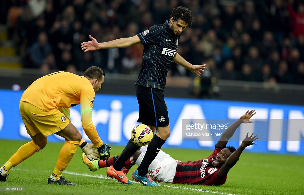 Samir Handanovic and <a gi-track='captionPersonalityLinkClicked' href=/galleries/search?phrase=Andrea+Ranocchia&family=editorial&specificpeople=4085825 ng-click='$event.stopPropagation()'>Andrea Ranocchia</a> of FC Internazionale and <a gi-track='captionPersonalityLinkClicked' href=/galleries/search?phrase=Michael+Essien&family=editorial&specificpeople=523500 ng-click='$event.stopPropagation()'>Michael Essien</a> of AC Milan compete for the ball during the Serie A match between AC Milan and FC Internazionale Milano at Stadio Giuseppe Meazza on November 23, 2014 in Milan, Italy.