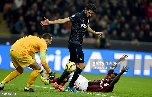 Samir Handanovic and Andrea Ranocchia of FC Internazionale and Michael Essien of AC Milan compete for the ball during the Serie A match between AC...