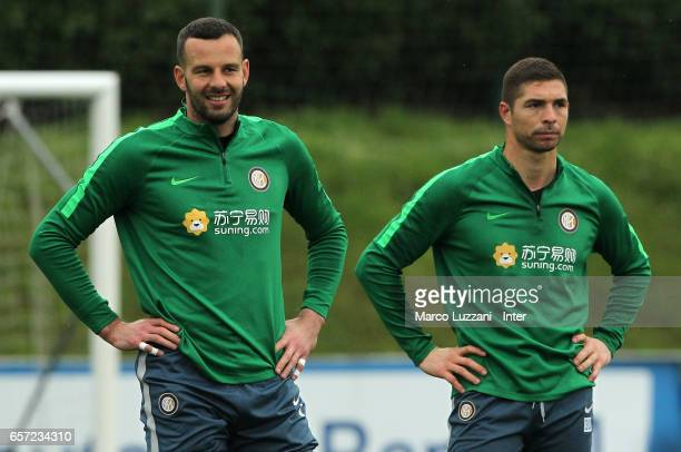 Samir Handanovic and Juan Pablo Carrizo of FC Internazionale Milano look on during the FC Internazionale training session at the club's training...