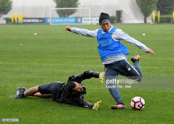 Samir Handanovic and Yuto Nagatomo of FC Internazionale compete for the ball during FC Internazionale training session at Suning Training Center at...