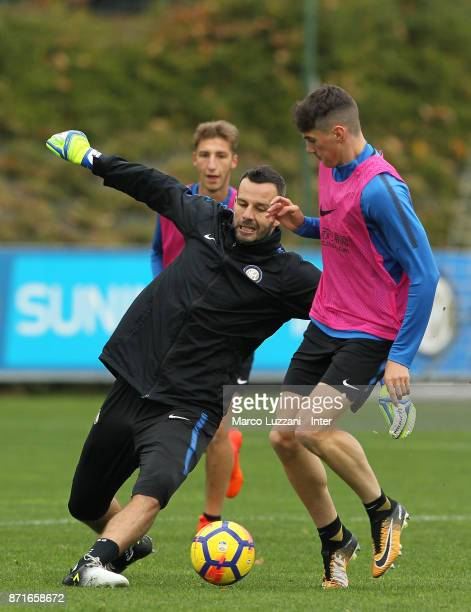 Samir Handanovic competes with Federico Valietti during the FC Internazionale training session at the club's training ground 'La Pinetina' on...