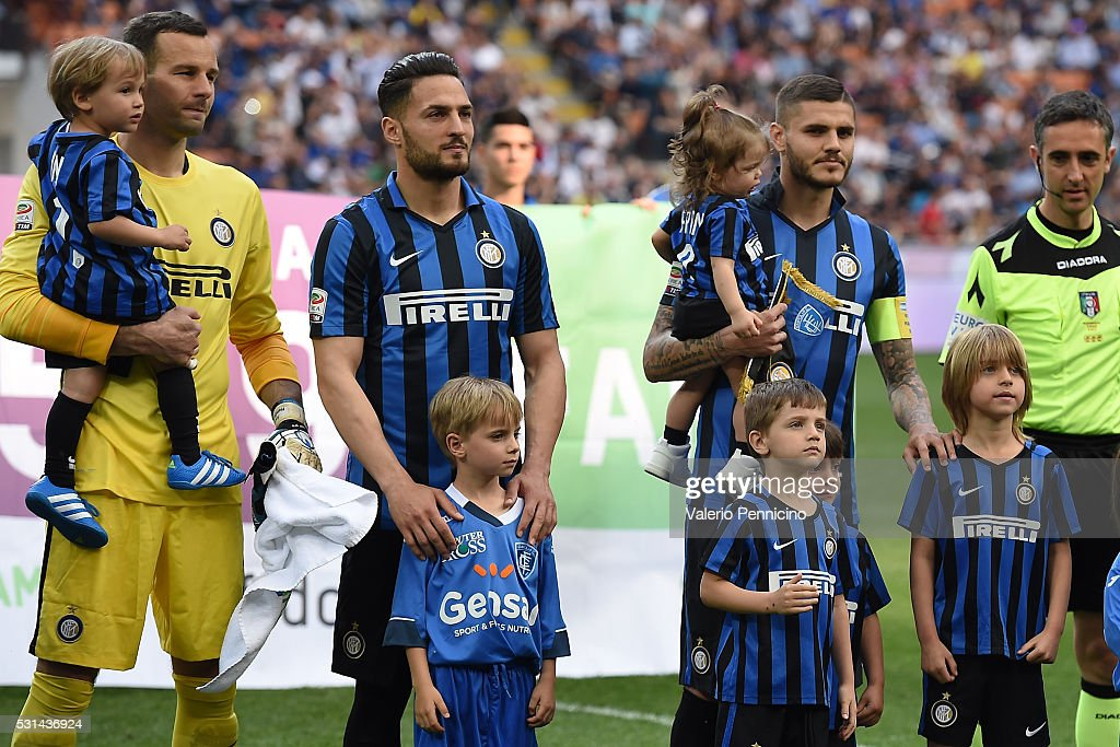 Samir Handanovic (L), Danilo D Ambrosio (C) and <a gi-track='captionPersonalityLinkClicked' href=/galleries/search?phrase=Mauro+Icardi&family=editorial&specificpeople=9761957 ng-click='$event.stopPropagation()'>Mauro Icardi</a> of FC Internazionale Milano line up with their childrens during the Serie A match between FC Internazionale Milano and Empoli FC at Stadio Giuseppe Meazza on May 7, 2016 in Milan, Italy.