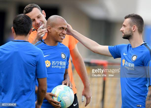 Samir Handanovic Joao Mario Marcelo Brozovic of FC Internazionale chat during a training session at Bishan Sports Hall on July 25 2017 in Singapore