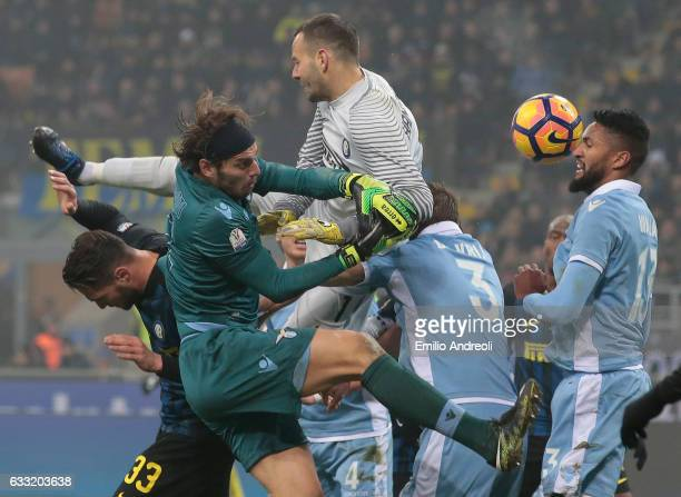Samir Handanovic of FC Internazionale Milano battles for the ball with Federico Marchetti of SS Lazio during the TIM Cup match between FC...
