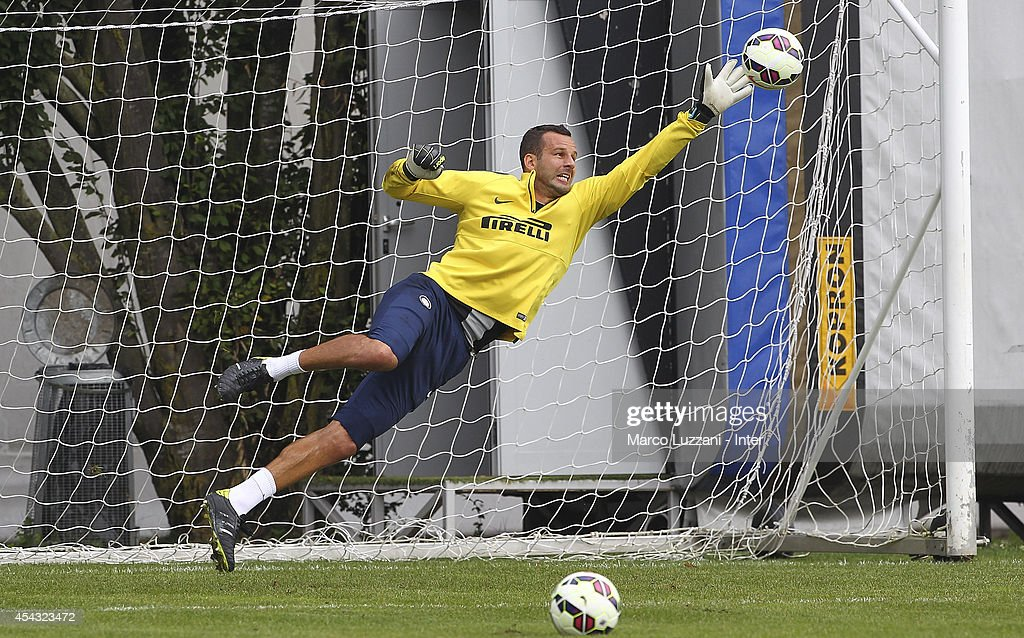 Samir Handanovic of FC Internazionale Milano dives to save a shot during FC Internazionale Training Session at the club's training ground on August 29, 2014 in Appiano Gentile Como, Italy.