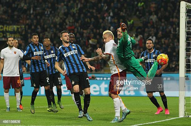 Samir Handanovic of FC Internazionale Milano dives to save a shot during the Serie A match between FC Internazionale Milano and AS Roma at Stadio...