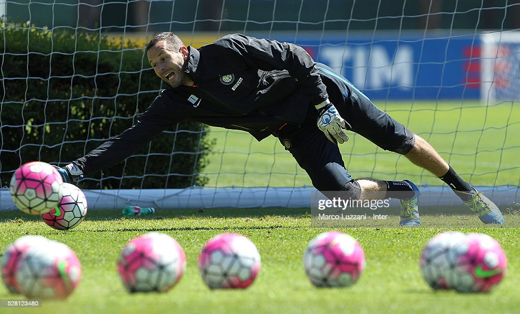 Samir Handanovic of FC Internazionale Milano dives to save a shot during the FC Internazionale training session at the club's training ground 'La Pinetina' on May 4, 2016 in Como, Italy.