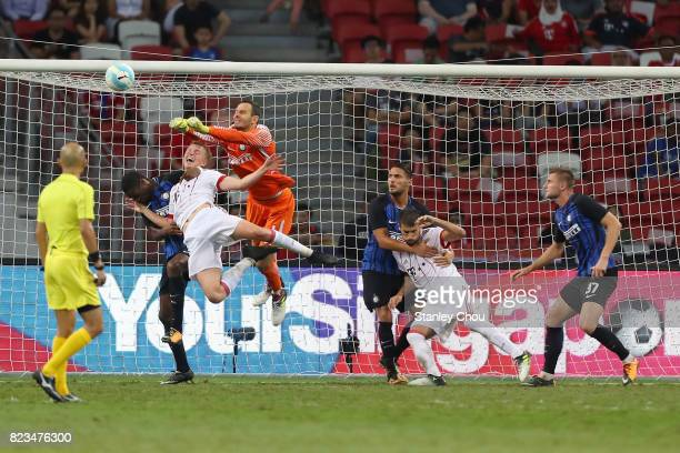 Samir Handanovic of FC Internazionale punches the ball away from Niklas Dorsch of FC Bayern during the International Champions Cup match between FC...