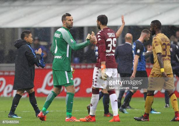 Samir Handanovic of FC Internazionale shake hands with Salvatore Sirigu at the end the Serie A match between FC Internazionale and Torino FC at...