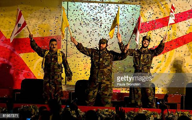 Samir Kantar and two other Lebanese prisoners freed by Israel wave to a crowd celebrating at a stadium July 16 2008 in Beirut's southern suburbs As...