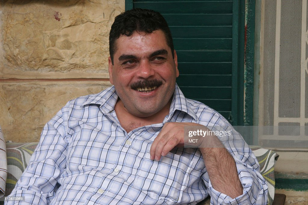 Samir Kuntar greets visitors on July 19, 2008, at his family home in Aabey, Lebanon. Kuntar spent nearly 30 years in an Israeli prison before being released on July 16, 2008, in a deal with Hezbollah.