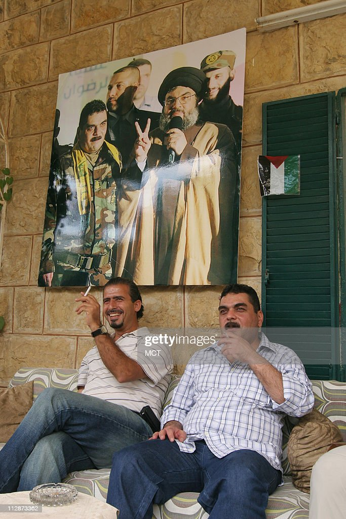 Samir Kuntar, right, meets at his family home with Anwar Yassin, a former Lebanese militant who was freed in 2005 as part of a prisoner exchange with Israel, on July 19, 2008, in Aabey, Lebanon. Kuntar spent nearly 30 years in an Israeli prison before being released on July 16, 2008, in a deal with Hezbollah.