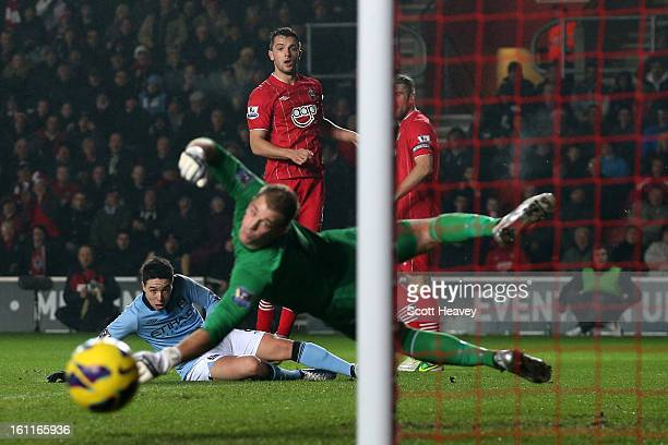 Samir Nasri and Joe Hart of Manchester City look on as Jay Rodriguez of Southampton's effort on goal goes wide during the Barclays Premier League...
