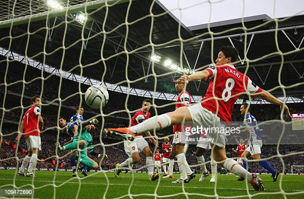 Samir Nasri of Arsenal fails to stop a header by Nikola Zigic of Birmingham City during the Carling Cup Final between Arsenal and Birmingham City at...