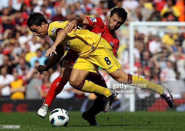 Samir Nasri of Arsenal is challenged by Javier Mascherano of Liverpool during the Barclays Premier League match between Liverpool and Arsenal at...
