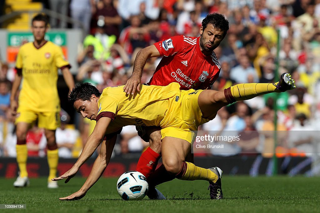 Samir Nasri of Arsenal is challenged by Javier Mascherano of Liverpool during the Barclays Premier League match between Liverpool and Arsenal at Anfield on August 15, 2010 in Liverpool, England.
