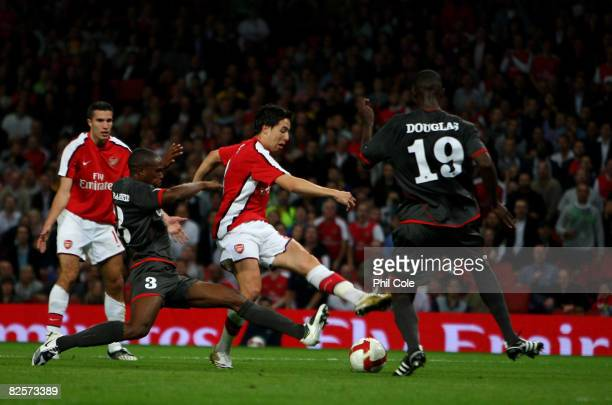 Samir Nasri of Arsenal scores against FC Twente during the UEFA Champions League third qualifying round second leg match between Arsenal and FC...