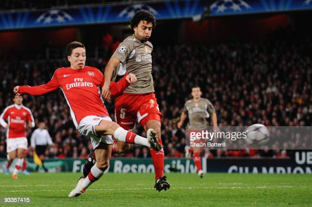 Samir Nasri of Arsenal scores the first goal during the UEFA Champions League group H match between Arsenal and Standard Liege at Emirates Stadium on...