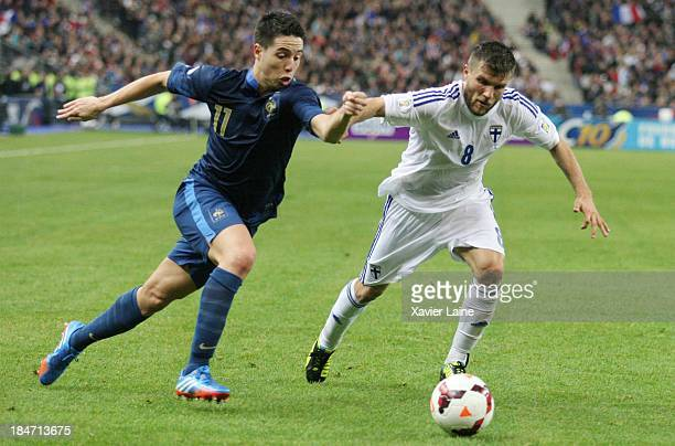 Samir Nasri of France and Perparim Hetemaj of Finland during the FIFA 2014 World Cup Qualifier France v Finland at Stade de France on October 15 2013...