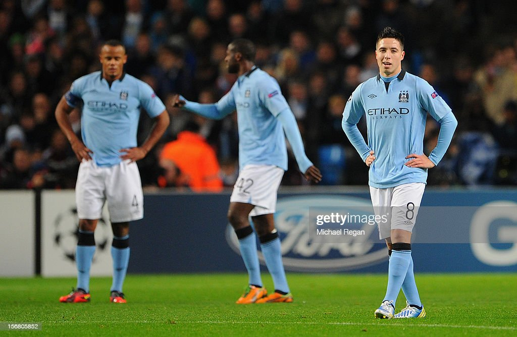 <a gi-track='captionPersonalityLinkClicked' href=/galleries/search?phrase=Samir+Nasri&family=editorial&specificpeople=648450 ng-click='$event.stopPropagation()'>Samir Nasri</a> of Manchester City and his team-mates look dejected after conceding the opening goal during the UEFA Champions League Group D match between Manchester City FC and Real Madrid CF at the Etihad Stadium on November 21, 2012 in Manchester, England.