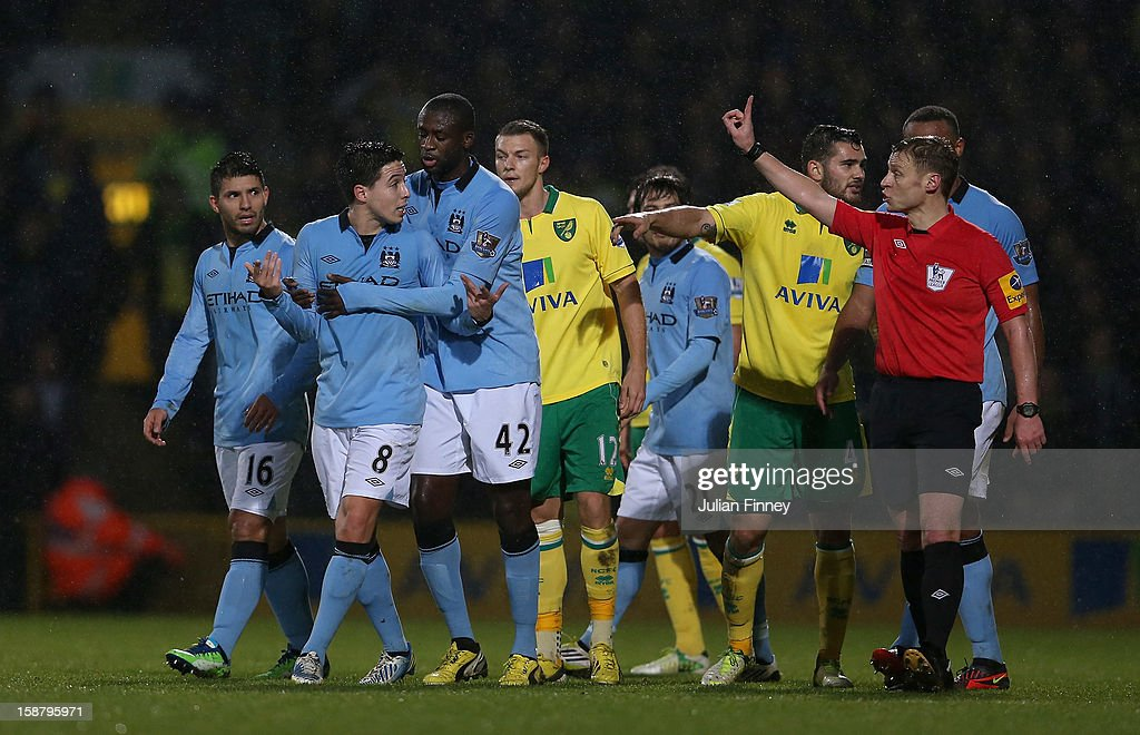 Samir Nasri of Manchester City argues after he is shown the red card by referee Mike Jones after he head butts Sebastien Bassong of Norwich City during the Barclays Premier League match between Norwich City and Manchester City at Carrow Road on December 29, 2012 in Norwich, England.