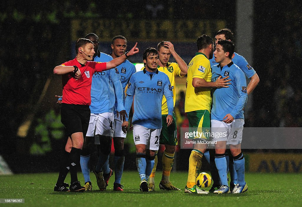 <a gi-track='captionPersonalityLinkClicked' href=/galleries/search?phrase=Samir+Nasri&family=editorial&specificpeople=648450 ng-click='$event.stopPropagation()'>Samir Nasri</a> of Manchester City argues after he is shown the red card by referee Mike Jones after he head butts Sebastien Bassong of Norwich City during the Barclays Premier League match between Norwich City and Manchester City at Carrow Road on December 29, 2012 in Norwich, England.