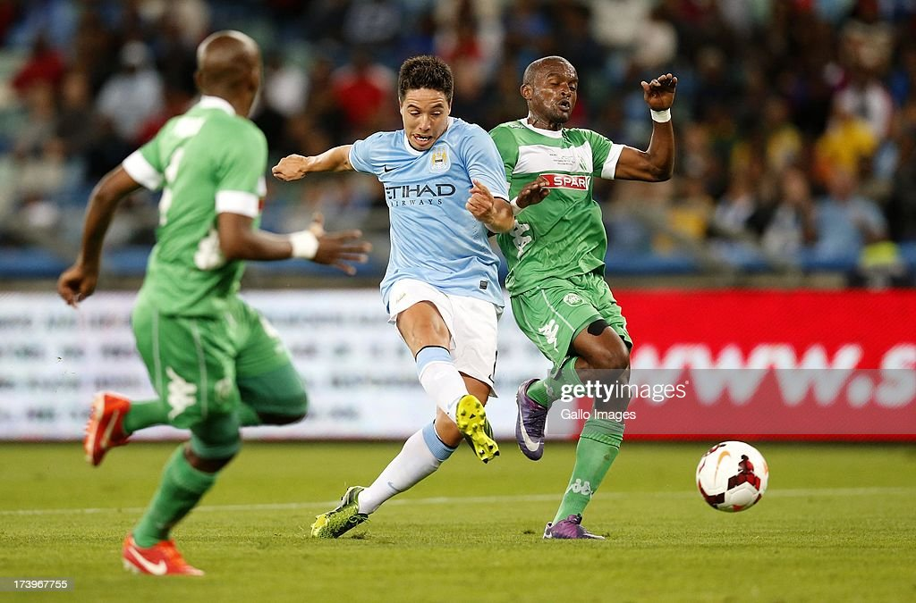Samir Nasri of Manchester City beats defenders during the Nelson Mandela Football Invitational match between AmaZulu and Manchester City at Moses Mabhida Stadium on July 18, 2013 in Durban, South Africa.