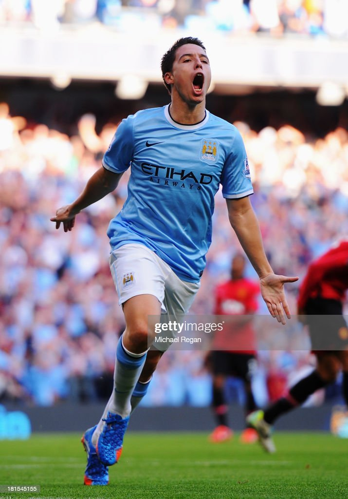 Samir Nasri of Manchester City celebrates as he scores their fourth goal during the Barclays Premier League match between Manchester City and Manchester United at the Etihad Stadium on September 22, 2013 in Manchester, England.