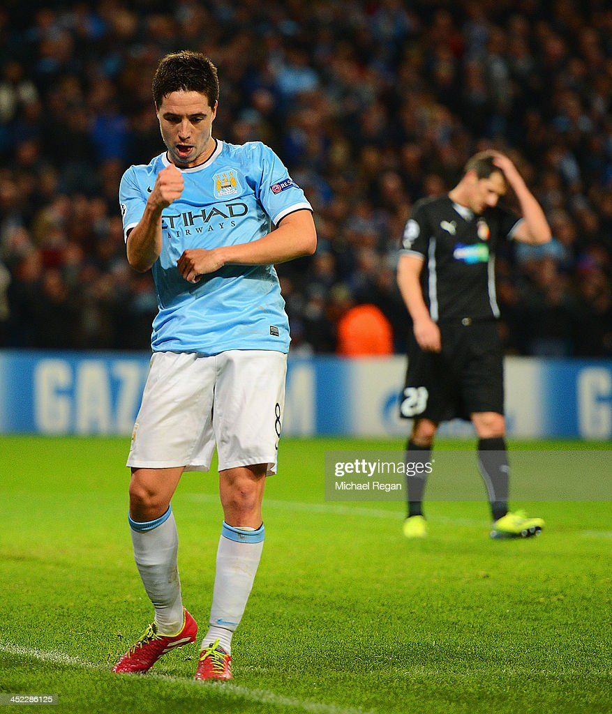 <a gi-track='captionPersonalityLinkClicked' href=/galleries/search?phrase=Samir+Nasri&family=editorial&specificpeople=648450 ng-click='$event.stopPropagation()'>Samir Nasri</a> of Manchester City celebrates his team's second goal during the UEFA Champions League Group D match between Manchester City and FC Viktoria Plzen at Etihad Stadium on November 27, 2013 in Manchester, England.