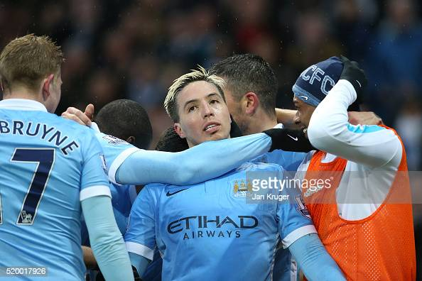 Samir Nasri of Manchester City celebrates scoring his team's second goal with team mates during the Barclays Premier League match between Manchester...