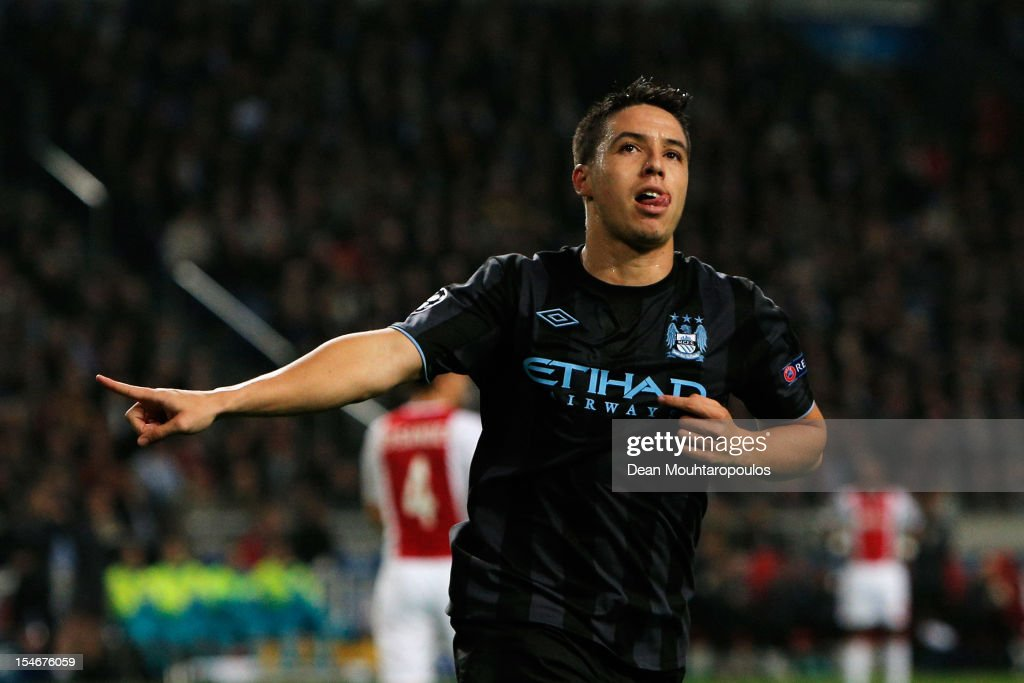 Samir Nasri of Manchester City celebrates scoring the first goal of the game during the Group D UEFA Champions League match between AFC Ajax and Manchester City FC at Amsterdam ArenA on October 24, 2012 in Amsterdam, Netherlands.