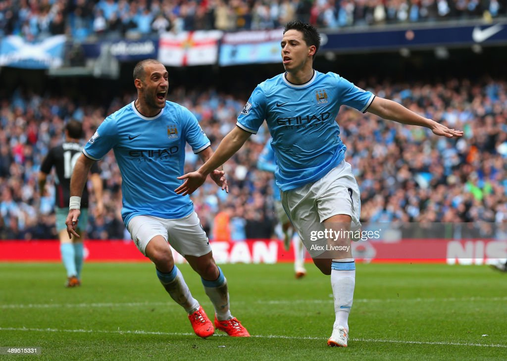 <a gi-track='captionPersonalityLinkClicked' href=/galleries/search?phrase=Samir+Nasri&family=editorial&specificpeople=648450 ng-click='$event.stopPropagation()'>Samir Nasri</a> of Manchester City celebrates scoring the first goal during the Barclays Premier League match between Manchester City and West Ham United at the Etihad Stadium on May 11, 2014 in Manchester, England.