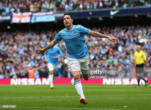 Samir Nasri of Manchester City celebrates scoring the first goal during the Barclays Premier League match between Manchester City and West Ham United...