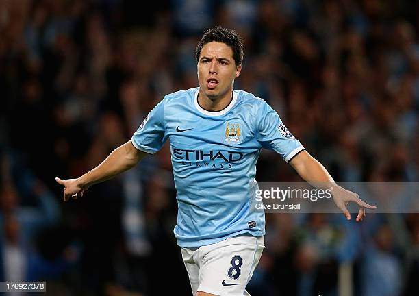 Samir Nasri of Manchester City celebrates scoring the fourth goal during the Barclays Premier League match between Manchester City and Newcastle...