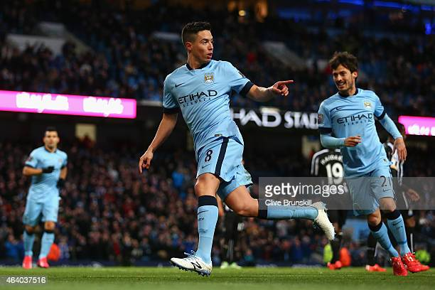 Samir Nasri of Manchester City celebrates scoring their second goal during the Barclays Premier League match between Manchester City and Newcastle...