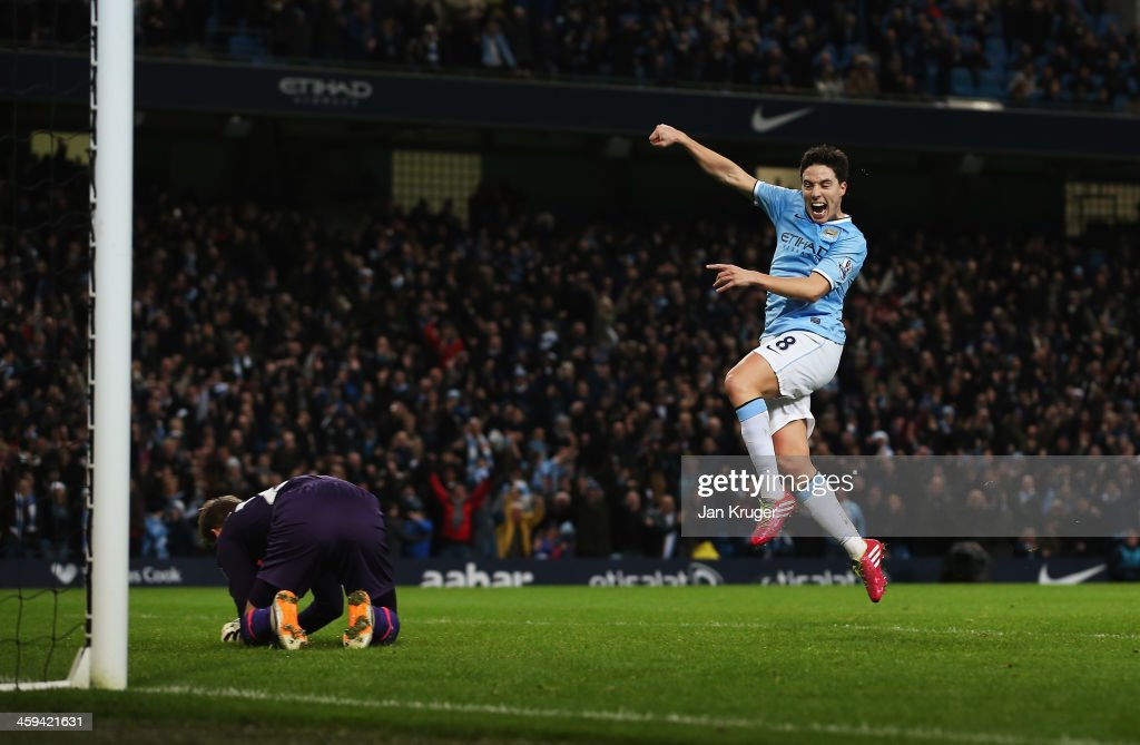 <a gi-track='captionPersonalityLinkClicked' href=/galleries/search?phrase=Samir+Nasri&family=editorial&specificpeople=648450 ng-click='$event.stopPropagation()'>Samir Nasri</a> of Manchester City celebrates the goal scored by Alvaro Negredo during the Barclays Premier League match between Manchester City and Liverpool at Etihad Stadium on December 26, 2013 in Manchester, England.