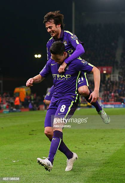 Samir Nasri of Manchester City celebrates with teammate David Silva of Manchester City after scoring his team's fourth goal during the Barclays...